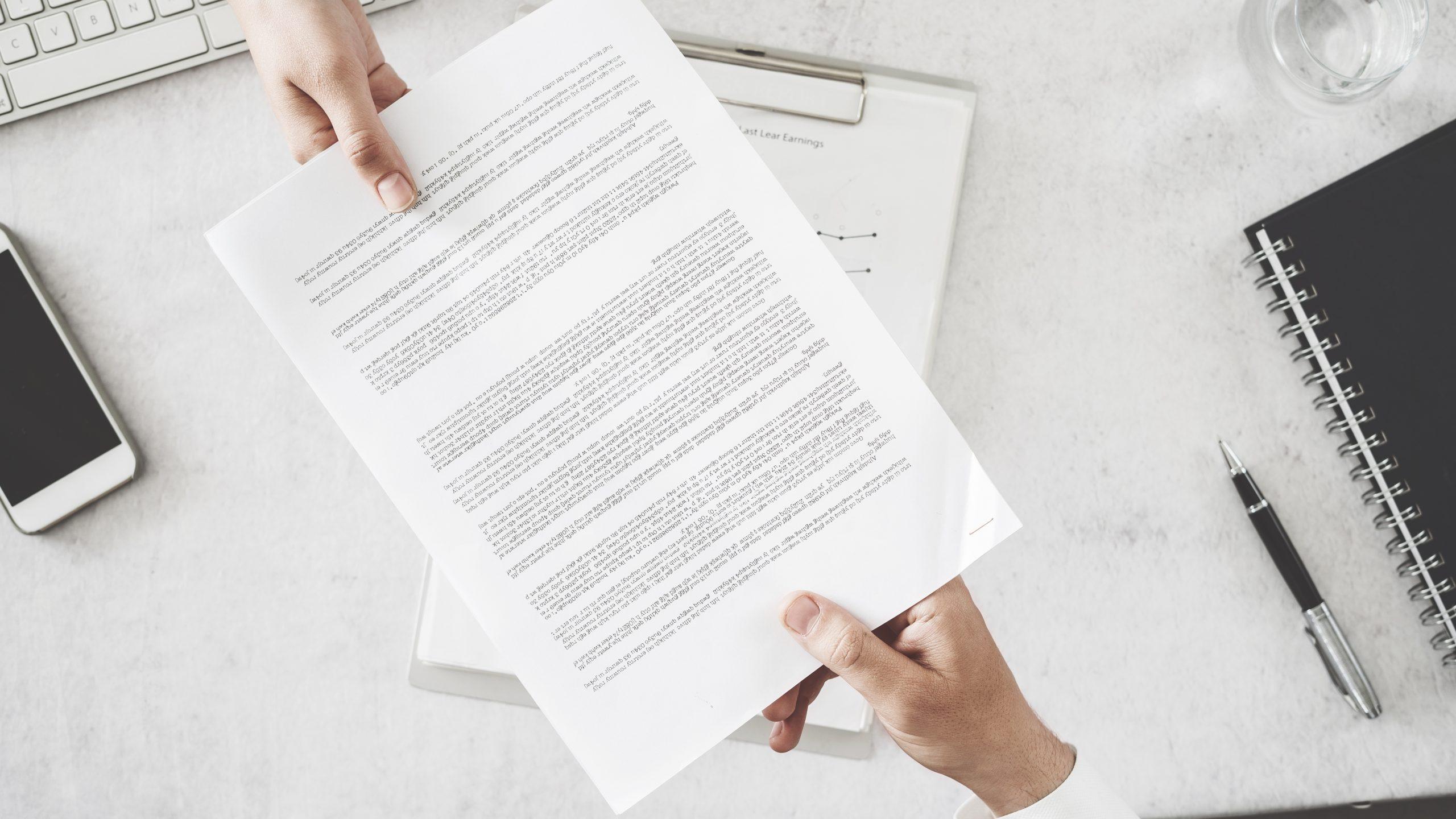 Franchise lawyer exchanging documentation
